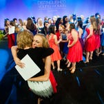 MaryGrace Long, representing Shelby County, hugs her mother Drew after being named  Alabama's Distinguished Young Woman on Saturday evening January 16, 2016 in Montgomery, Ala.