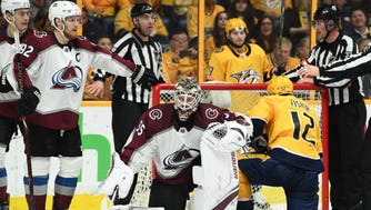Colorado Avalanche goalie Andrew Hammond (35) covers the puck after pressure from Nashville Predators center Mike Fisher (12) during the second period of Game 5.