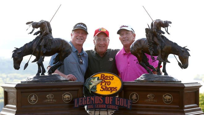 2016 Bass Pro Shops Legends of Golf winners Woody Austin (right) and Michael Allen with Bass Pro Shops founder  Johnny Morris after allen and Austin won at Top of the Rock golf course in Ridgedale, Mo. on Sunday, April 24, 2016.