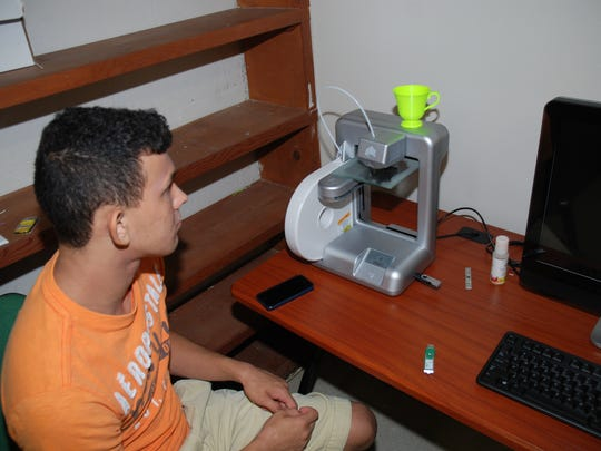 Connect My Louisiana student worker Kaleb Danos, of Washington Parish, prepares to make a rook for his chess board with the 3-D printer in the AgCenter Washington Parish office.