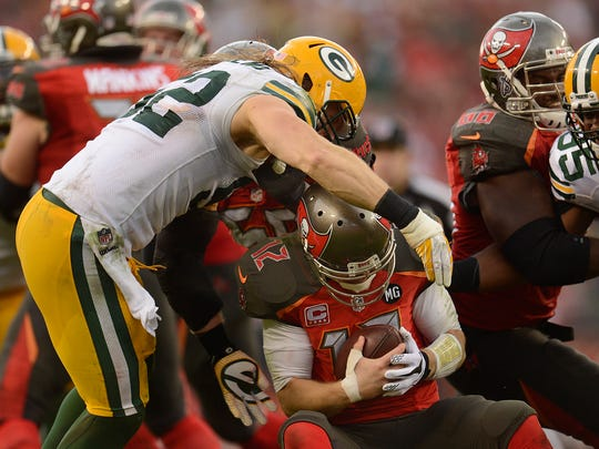 Green Bay Packers linebacker Clay Matthews (52) sacks Tampa Bay Buccaneers quarterback Josh McCown (12) in the fourth quarter during Sunday's game at Raymond James Stadium in Tampa, Fla.