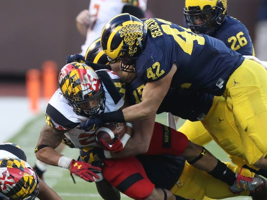 Michigan Wolverines'  Ben Gedeon tackles Maryland Terrapins' Lorenzo Harrison during the second half Saturday, Nov. 5, 2016 at Michigan Stadium.