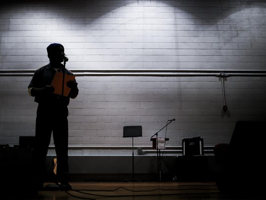 Inmate Roosevelt Harris performs at the Handlon Correctional