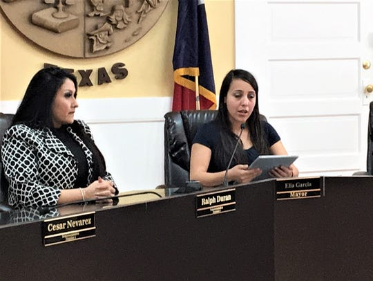 Socorro Mayor Elia Garcia, center, talks at a news