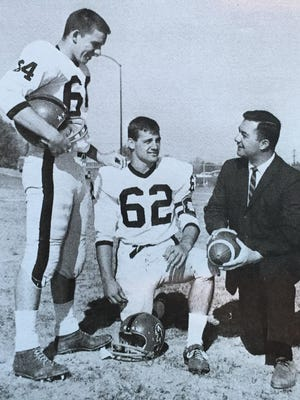 Oak Hills head football coach Wil Rutenschroer chats with team co-captains Ed Orlemann and Don Mercurio in 1963.