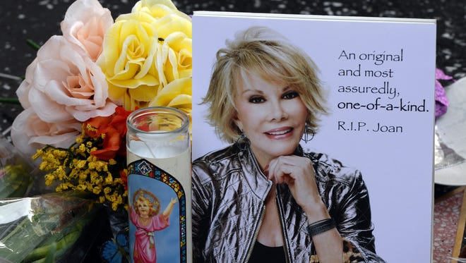 Flowers are placed on the Hollywood Walk of Fame Star for Joan Rivers on Sept. 4.