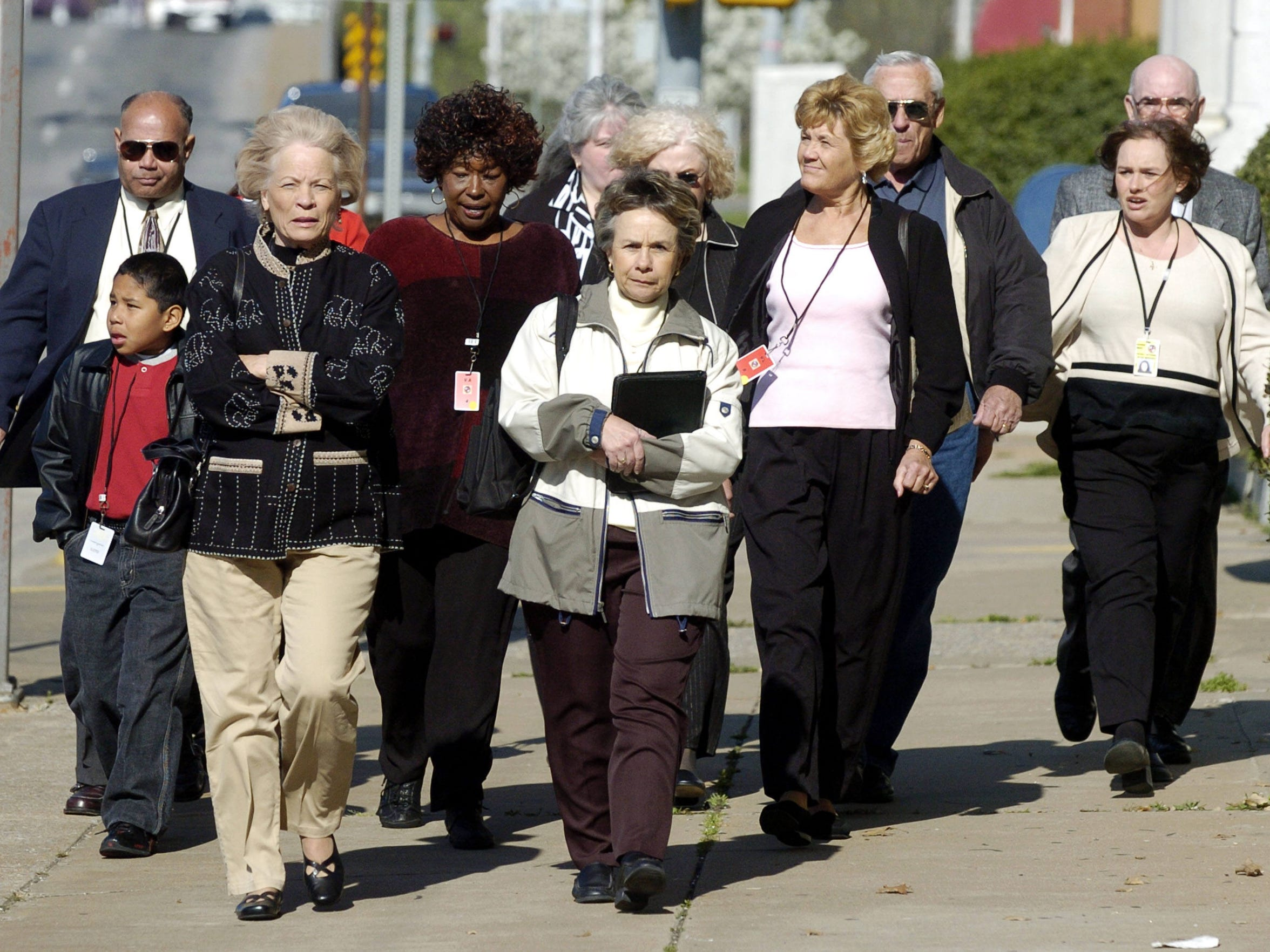 Family and friends of Oklahoma City bombing victims walk into the McAlester County Courthouse on the first day of Terry Nichols' trial on March 22, 2004.