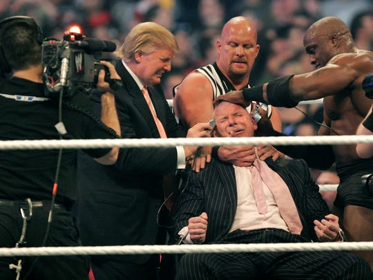 WWE chairman Vince McMahon has his head shaved by Donald Trump (left) and Bobby Lashley (right) while being held down by ''Stone Cold'' Steve Austin at the 2007 WWE Wrestlemania.