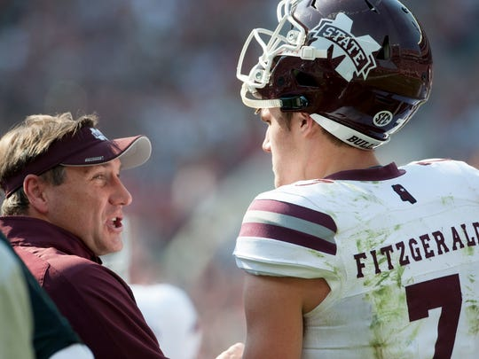 Mississippi State head coach Dan Mullen talks with Mississippi State quarterback Nick Fitzgerald (7) against Alabama at Bryant Denny Stadium in Tuscaloosa, Ala. on Saturday November 12, 2016. (Mickey Welsh / Montgomery Advertiser)