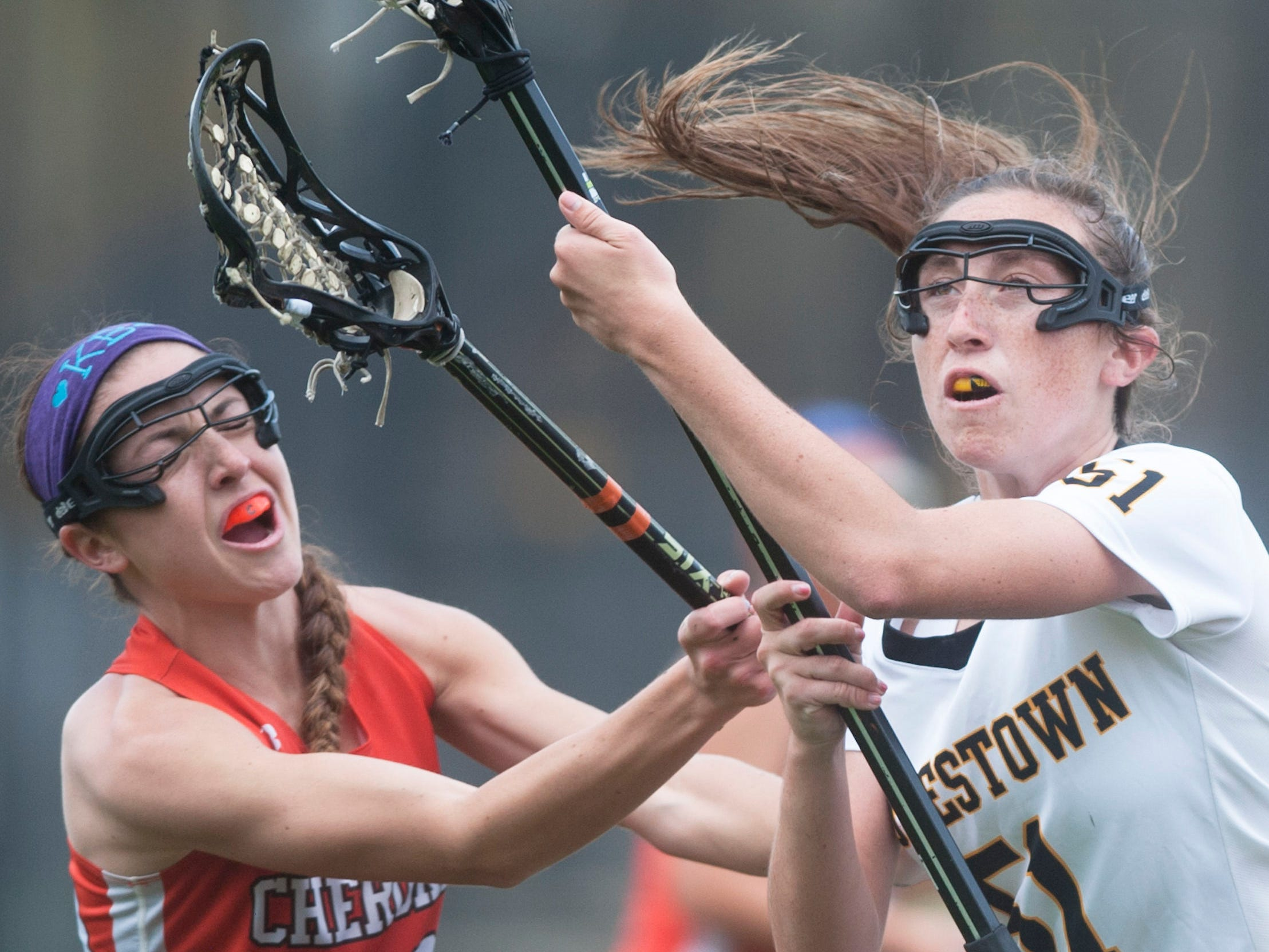 Moorestown's Melanie Becker, right, controls the ball next to Cherokee's Savannah Singer as Becker drives to the goal prior to scoring a goal during the 1st half of Wednesdays game played in Moorestown. 04.22.15
