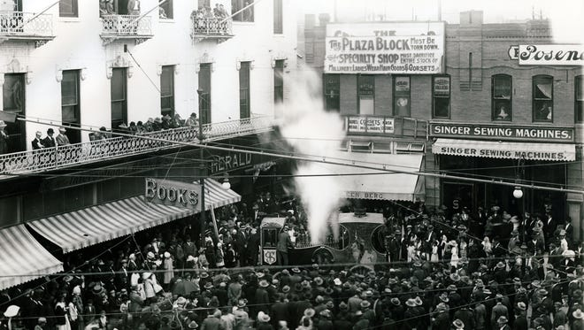 """The Sells-Foto circus parade ended with a free calliope concert in Pioneer Plaza in this April 3, 1911, photo. """"And the calliope ... was the last and best,"""" a Times reviewer wrote. """"Harry Wills, not professor, but the real thing, did things on that boiler shop musical instrument that would make the boy with the lion-like mane go back to his spaghetti shop. Notes as big as walnuts, to quote friend Abe Martin, were emanating from that calliope like the balloons from the roof of The Herald building with the free tickets attached."""""""