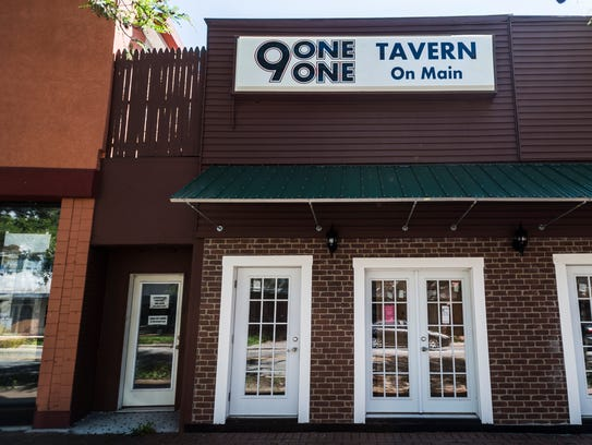 The front facade of 9-1-1 Tavern on Main is seen in