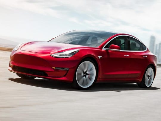 German car registrations for Tesla rose more than five times to 2,367 vehicles in March, following the Model 3's, shown, introduction to Europe in February. The sales total, which includes models S and X, puts Tesla just 356 vehicles shy of Volkswagen AG-owned Porsche, monthly figures from the Federal Motor Transport Authority show.