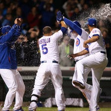 Sept. 15: Cubs first baseman Anthony Rizzo (second from right) is hit with water thrown by teammates after hitting a walk-off solo home run against the Cincinnati Reds during the ninth inning at Wrigley Field.
