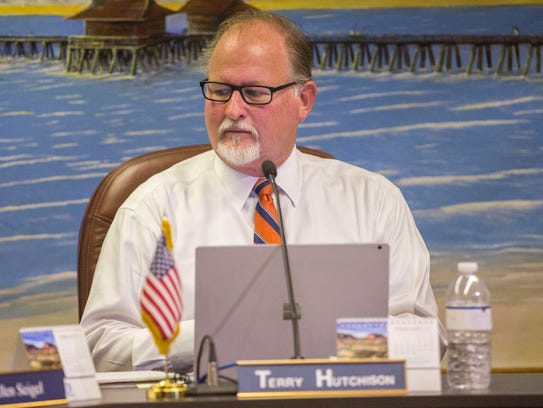 Newly sworn-in Naples City Council member Terry Hutchison