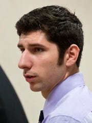 Brandon Belliveau, one of five former Milton High School football players accused of hazing, pleads not guilty to a charge of simple assault in Vermont Superior Court in Burlington on Tuesday.
