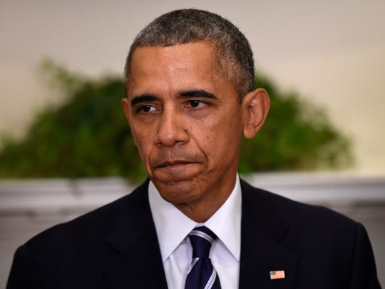 President Barack Obama pauses while making a statement