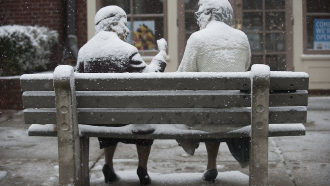 A Haddonfield statue gets a coating during a light February snow.