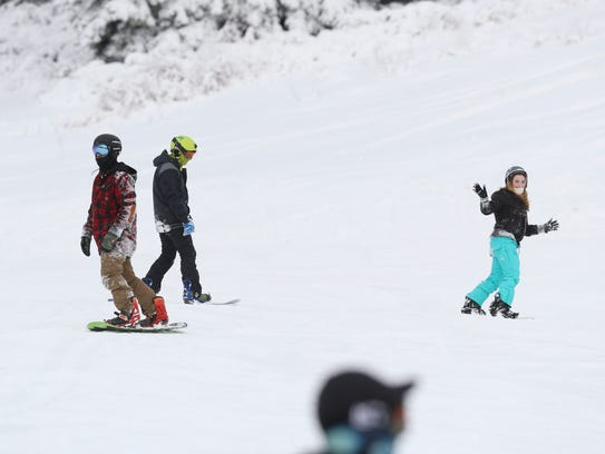 Skiers and snowboarders hit the slopes Friday at the