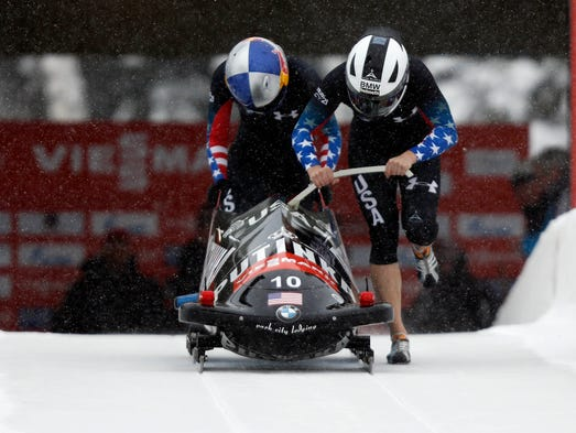 Lolo Jones, left, and Jamie Greubel of the United States during the IBSF women's bobsleigh World Cup on Dec. 7, 2013, at Utah Olympic Park.