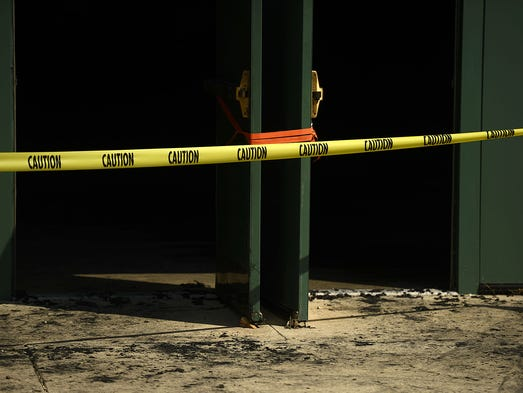 Charred marks are shown on the sidewalk outside the side doors to the main gymnasium at Green Bay Preble High School on Friday, Aug. 8, 2014. An early-morning fire caused extensive damage to the gym and smoke damage throughout the school.