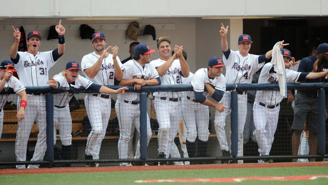 Mississippi players celebrate against Jacksonville State at the NCAA Oxford Regional at Oxford-University Stadium on Saturday, May 31, 2014.  (AP Photo/Oxford Eagle, Bruce Newman)