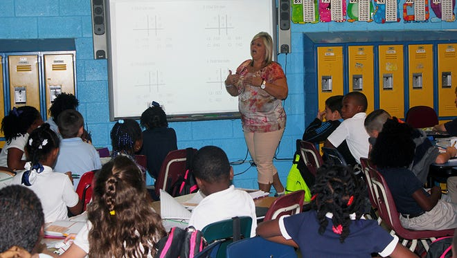 Carroll County teacher Barbara Miller says she is happy to make a 30-minute commute to teach.
