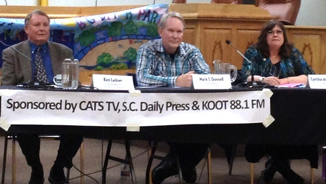 The three candidates for mayor, Ken Ladner, Mark Donnell and Cynthia Ann Bettison, seen here at a forum in January, will be featured at a town hall meeting, hosted by the Grant County Democratic Party, on Thursday.