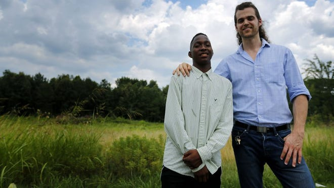 Chauncy Black, 15, (left) approached Matt White in a Kroger grocery store on June 9 asking to help White with his groceries in exchange for some doughnuts. White started a GoFundMe campaign in hopes of raising $250 to purchase a lawn mower to help Black earn money, but the story exploded on social media and donations have now totaled more than $250,000.