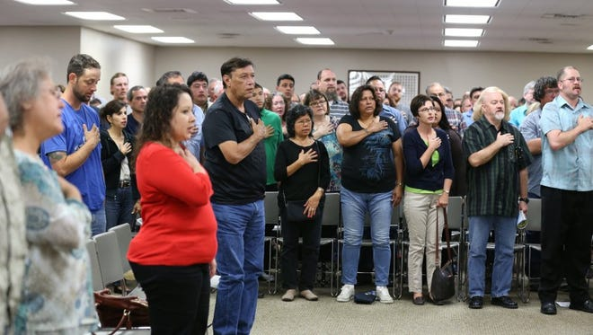 Potential jurors say the Pledge of Allegiance in the Central Jury Room at the Nueces County Courthouse.