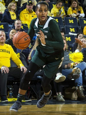 Shay Colley, shown here in a January game against Michigan, scored 10 of her 14 points in the second half, leading a balanced attack that helped ninth-seeded Michigan State pull away from eighth-seeded Northwestern, 68-52, in the second round of the Big Ten conference tournament on Thursday.