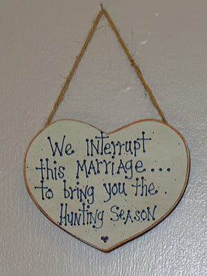 "A popular knickknack hangs in many hunters' homes: ""We Interrupt this Marriage to Bring You the Hunting Season."""