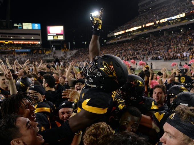 Arizona State players and fans celebrate after the