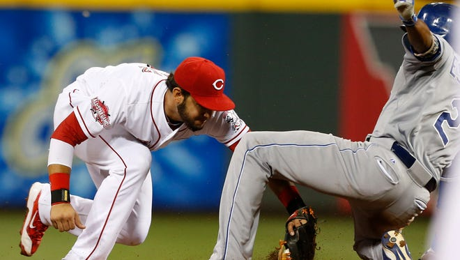 Royals shortstop Alcides Escobar slides into second as Reds shortstop Eugenio Suarez attempts the tag during the 11th inning Tuesday at GABP. After a review, Escobar was called out.