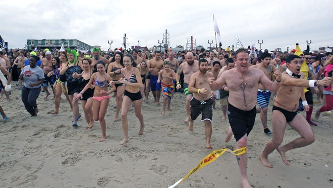 Participants head to the sea at the Seaside Heights Polar Plunge on Saturday, Feb. 20, 2016.  Photo by Vincent DiSalvio / Special to The ASBURY PARK PRESS