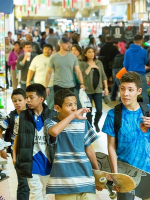 "Crowded shopping centers and congested roadways have marked the days leading up to Christmas in Las Cruces. From right, Mateo Jaramillo, 15, Joshua Bustillos,12, Romero Madrid, 14, and Shuggy Bustillos, 11, walk down the hallways of Mesilla Valley Mall on Friday, December 23, 2016. ""We are buying gifts,"" Madrid said. ""I wish we came sooner, it is extremely busy here."""