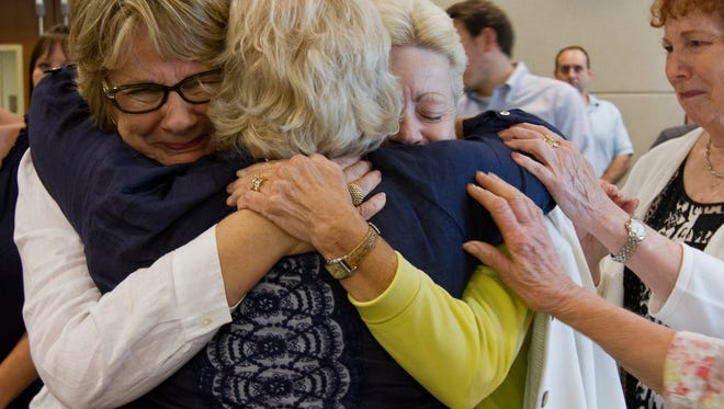 Susan Homan, center, is consoled by friends seconds after a guilty verdict was announced Friday afternoon during the double homicide trial of of Michael Spiegel for the killings of his ex-wife, Marilyn Spiegel and her fiance, Harry Carlip in May 2014.