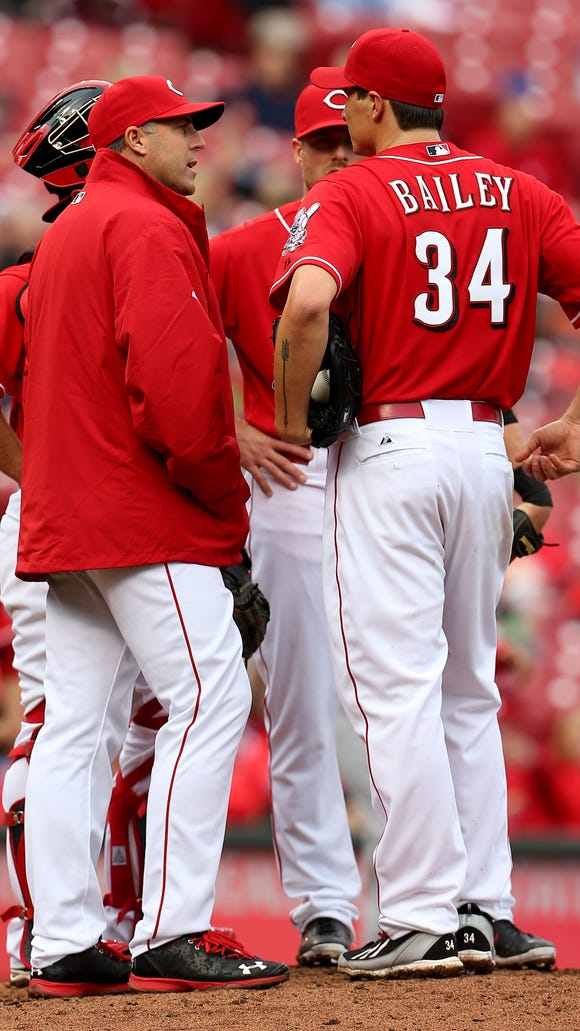 Cincinnati Reds manager Bryan Price (38) goes to relieve starting pitcher Homer Bailey (34).