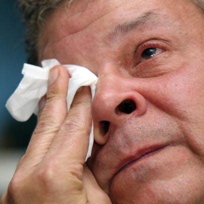 """Edward """"Don"""" Godawa, of Elsmere, breaks down as he talks about the death of his son, Michael Godawa, 21, who was shot and killed by an Elsmere Police officer during a traffic stop in 2012. A civil suit filed in the case that had been dismissed has been reinstated by a three-judge panel."""