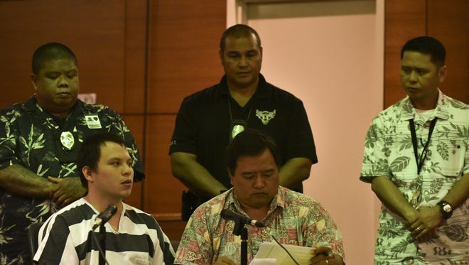 Keith Garrido, left, attends his change-of-plea hearing at the Superior Court of Guam in February. He pleaded guilty to murdering Nancy Mafnas in 2012.
