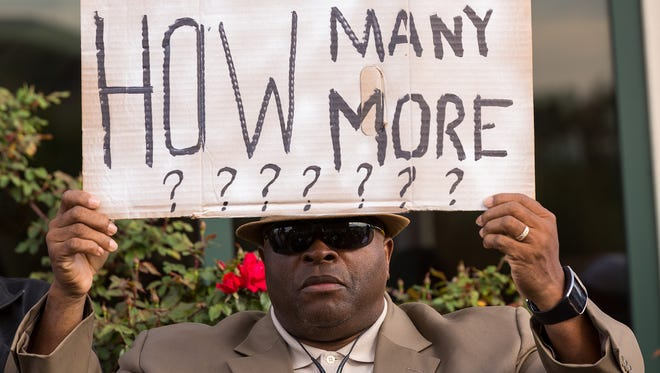 People 0participate in a rally to protest the death of Walter Scott, who was killed by police in a shooting, outside City Hall on April 8, 2015 in North Charleston, S.C.
