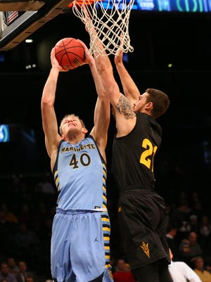 Nov 24, 2015: Marquette Golden Eagles center Luke Fischer (40) shoots the ball as Arizona State Sun Devils forward Eric Jacobsen (21) defends during the first half in the championship game of the Legends Classic at Barclays Center.