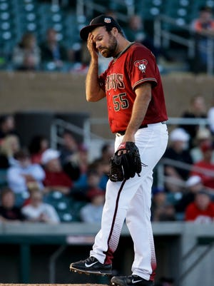 Arizona Diamondbacks relief pitcher Josh Collmenter reacts after  giving up a home run to Los Angeles Angels' Carlos Perez during sixth inning of a spring baseball game on March 8, 2016.