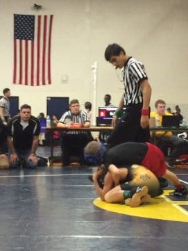 Justin Gates (black shirt) of the Marysville Club Wrestling program makes a move at a competition.