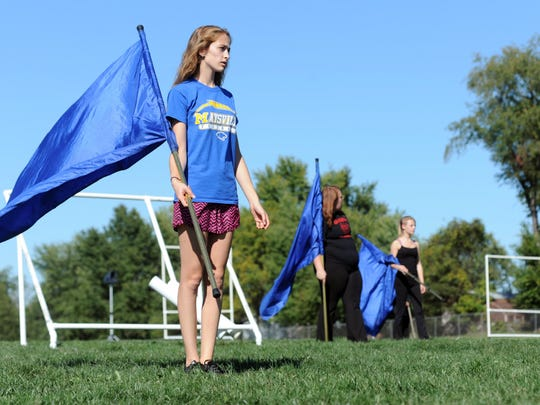 Ashley Hina, 16, flag corps captain, practices with the rest of the Maysville High School marching band in preparation for the Buckeye Invitational, hosted Saturday at Ohio State University's Ohio Stadium.