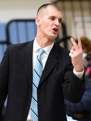 Steve Re, Cape Head Coach calls for 2 points as Cape Henlopen defeated Sussex Tech 60-53 at the school near Lewes on Wednesday.