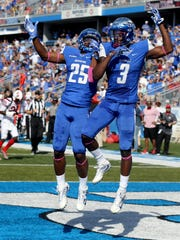 MTSU's Desmond Anderson (25) and Richie James (3) celebrate James' touchdown during the homecoming game against WKU on Saturday, Oct. 15, 2016.