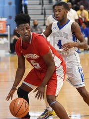 #5 of Smyrna Jaymeir Garnett grabs the ball as Smyrna High School (red) defeated Howard High School (white) 86-53 in the opening game of the Slam Dunk to the Beach Tournament held at Cape Henlopen High School on Wednesday December 27th.  Special to the News Journal / CHUCK SNYDER