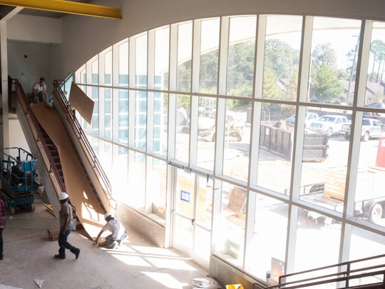 Workers new the large front window of the enrichment center at Episcopal School of Acadiana's Lafayette campus Dec.1, 2016. The center will open in January. It will have resources including robotics, engineering, history and more.