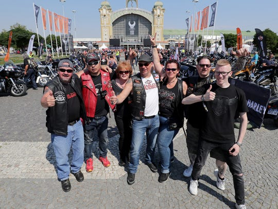 Gary Radmer of Slinger (from left); Wong Si Wei of Shanghai, China; Wendy Radmer of Slinger; Theo and Peggy Kindts of Amsterdam; Robert Van Ollefen of Amsterdam, and his son Duncan Van Ollefen gather at the Harley-Davidson 115th anniversary celebration in Prague. The group met at the Harley-Davidson Praha dealership.